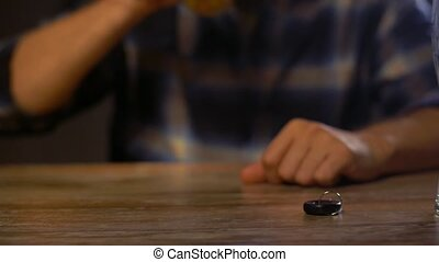 male driver drinking alcoholic beer at home or bar