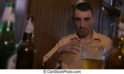 Alcohol addicted drunk man standing by the bar feeling sick