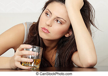 Alcohol addicted - Yound beautiful woman in depression, ...