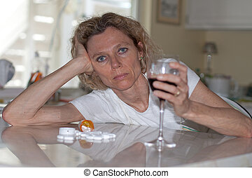 alcohol and drug abuse - mature addictet woman drinking wine...