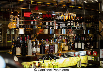 Alcohol Behind the Bar Counter - Front view of behind the...