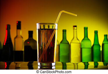 Alcohol cocktail with straw on bar