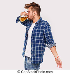 Alcohol. Guy in blue shirt with beer