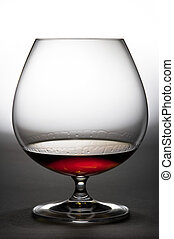 Alcohol in glass, game of light. - Glass with cognac against...