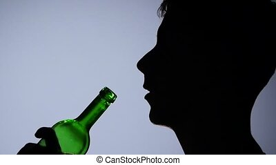 Alcohol. Men drinking red wine with bottle. Grey. Close up. Slow motion