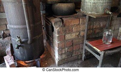 Alcohol process apparatus on fire distillate hooch drink. 4K...