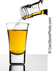 The strong alcohol flowing from a bottle