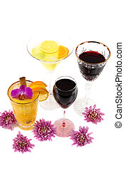 Alcoholic Beverages - Cocktails and red wine in various...