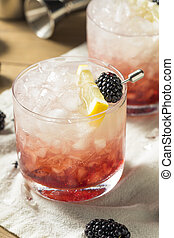 Alcoholic Blackberry Gin Bramble Cocktail with Lemon