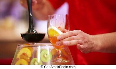 Alcoholic cocktails - Barman pours alcoholic cocktails party