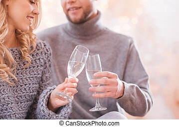 Close up of glasses being filled with champagne