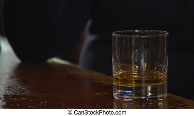 Alcoholic drink on glass - A steady close up shot of a...