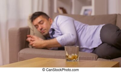 alcoholic drinking whiskey and sleeping at home -...
