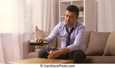 alcoholic pouring red wine to glass at home - alcoholism,...