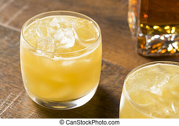 Alcoholic Scotch Penicillin Cocktail with Lemon and Ginger