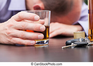 Alcoholic sleeping on the table with car keys
