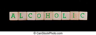Alcoholic spelled out in old wooden blocks