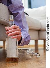 Alcoholic with bottle of vodka