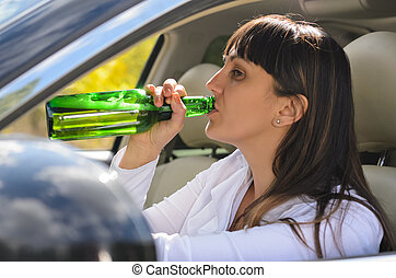 Alcoholic woman drinking a driving