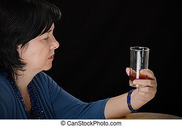 Alcoholic woman with glass of brandy