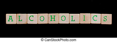 Alcoholics spelled out in old wooden blocks