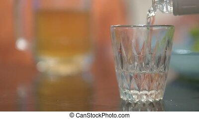 alcoholism concept, close-up, a man holds a beer glass and a...