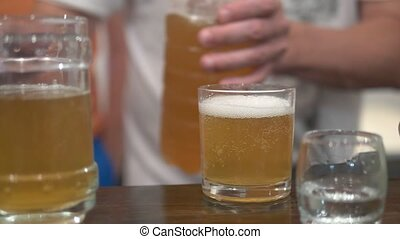 alcoholism concept, close-up, a man pours beer into a glass.