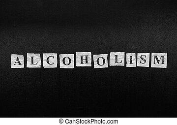 Paper notes with the word Alcoholism