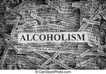 Torn pieces of paper with the word Alcoholism