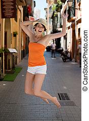alegría, mujer, joven, saltar, exuberante
