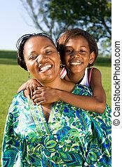 alegre, africano, madre e hija
