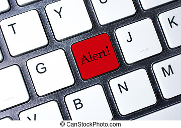 Alert button on white computer keyboard