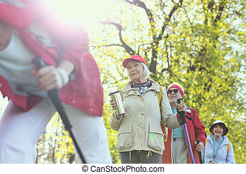 Alert woman holding a thermos bottle