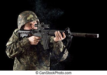 Alerted soldier keeping a smoking gun
