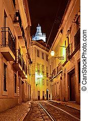 Alfama quarter at night in Lisbon, Portugal