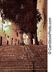 Alfama street at night in Lisbon, Portugal