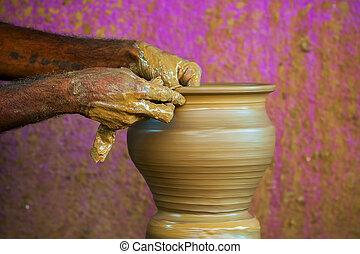 alfarero, manos
