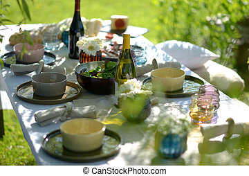 Alfresco dining, table set for an evening meal outside