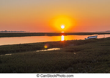 Algarve sunset seascape at Ria Formosa wetlands reserve,...