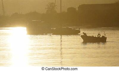 Algarve - Tavira Island - Sunset - Boats silhouette at...