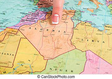 Female finger pointing at Algeria.