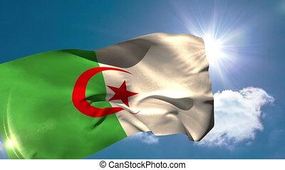 Algeria national flag waving on blue sky background with sun...