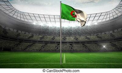 Algeria national flag waving on flagpole in football stadium...