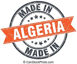 Algeria orange grunge ribbon stamp on white