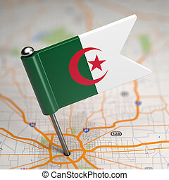 Algeria Small Flag on a Map Background.