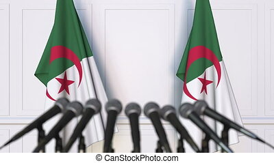 Algerian official press conference. Flags of Algeria and...