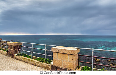 Alghero seafront on a cloudy day