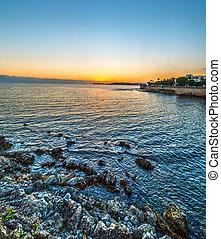 Alghero shoreline under a clear sky