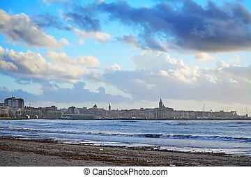 Alghero shoreline under a dramatic sky
