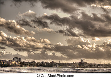 alghero under a cloudy sky. Processed for sepia tone effect.